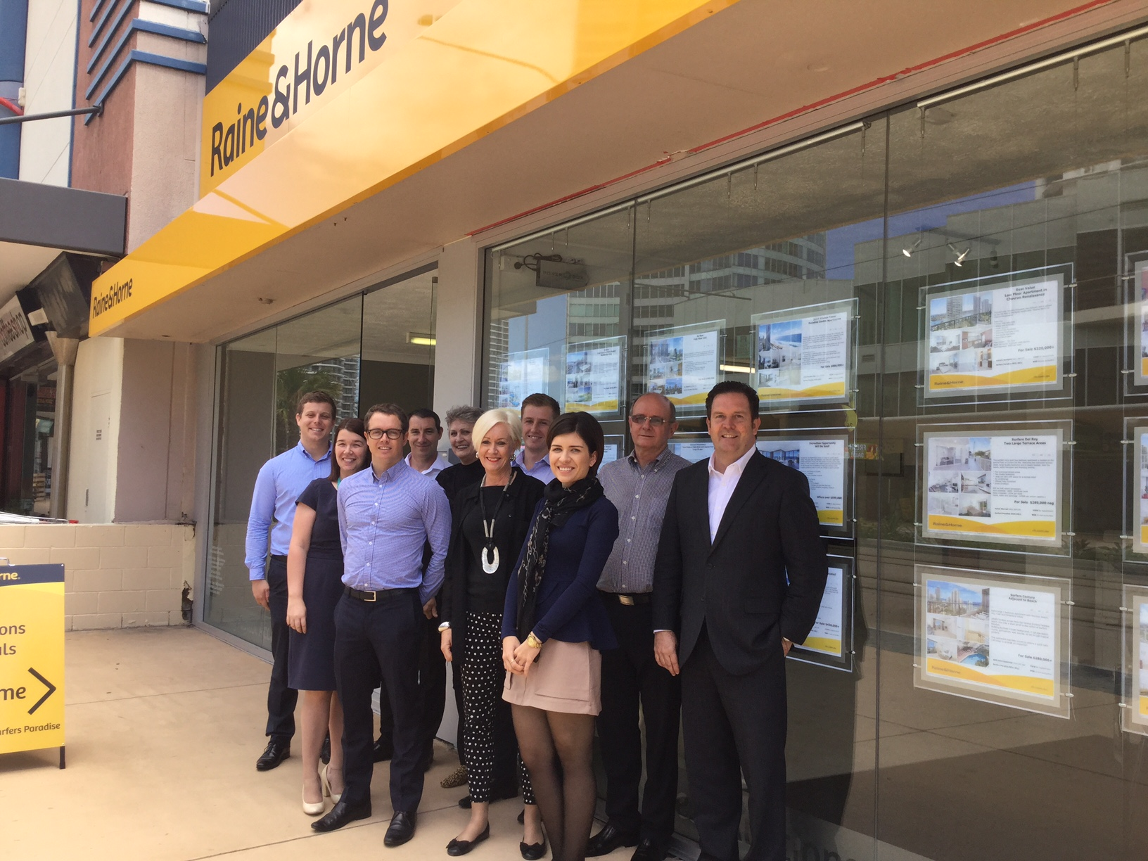 Angus Raine (R) visits the revamped Surfers Paradise office