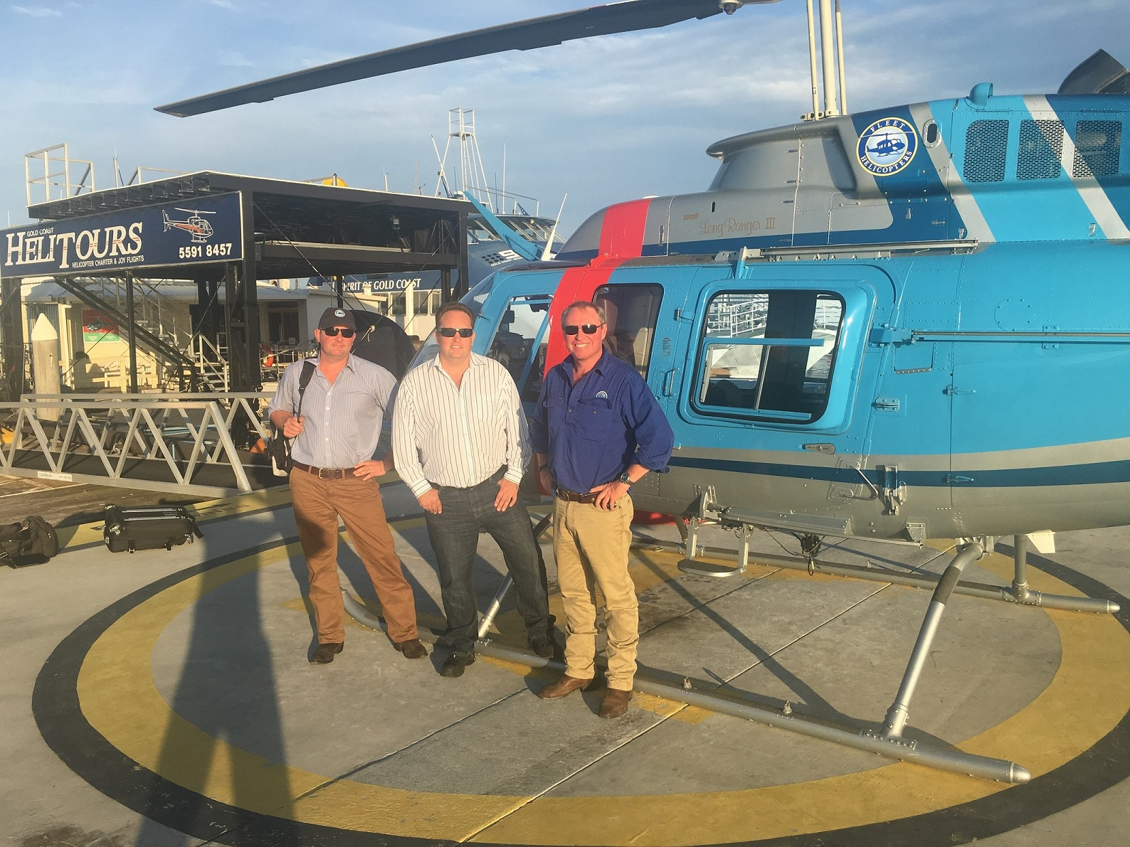L to R Andrew Tout, Raine & Horne Rural Sydney,  investor Nick Venter and Lachie Onslow, Fleet Helicopters
